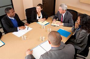 Business people negotiating at a table