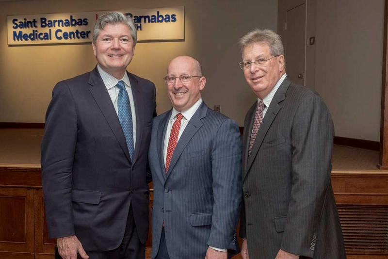 Stephen P. Zieniewicz, FACHE, president and chief executive officer at Saint Barnabas Medical Center (left), and Michael Scoppetuolo, M.D., chief medical officer of the Cancer Center at Saint Barnabas Medical Center (right), join Steven K. Libutti, M.D., FACS,