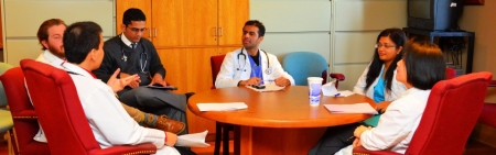 Medical Residents at Table Discussion