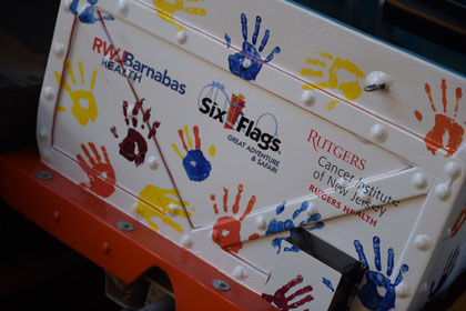Colorful hand prints of cancer survivors and supporters adorn the Runaway Mine Train