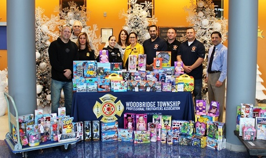 Woodbridge Township Firefighters Association and Police Department Donate Toys to BMSCH