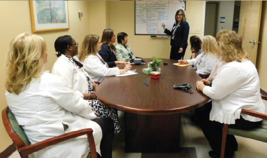nurses at Monmouth Medical Center Southern Campus discussing patient safety