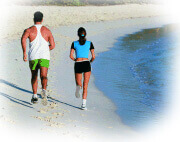 Couple running on a beach