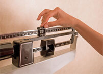 person measuring weight on a scale