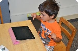 little boy on ipad