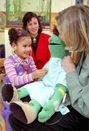 Girl Using Stethoscope on Puppet