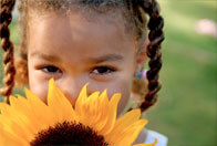 Child with a sunflower
