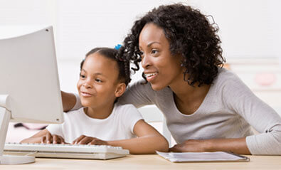 Mother and daughter looking at a computer