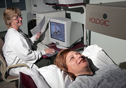 Woman laying down for a bone density scan