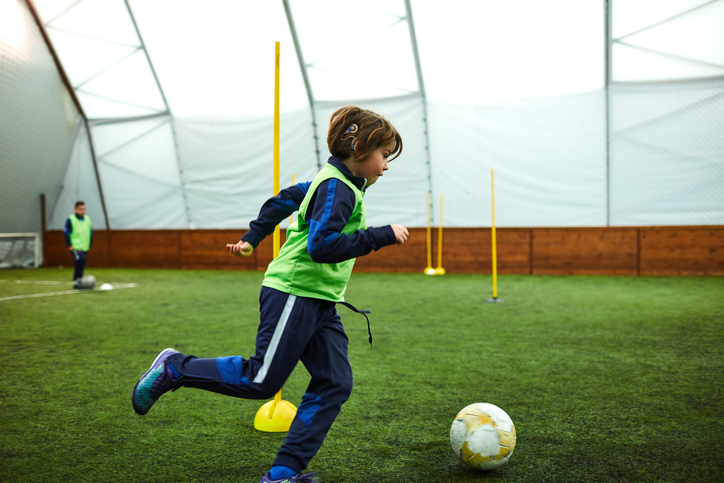 Kid with Cochlear Implant Playing Soccer