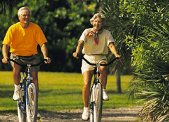 old couple on bikes