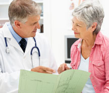 Physician going over chart with patient.