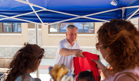 Joseph F. Scott, FACHE President and CEO Jersey City Medical Center greets local residents in front of the new RWJBarnabas Health at Bayonne facility at the Hometown Fair held on June 10 and 11.