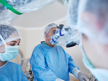 Physicians performing robotic surgery